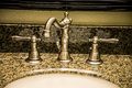 Nickle bathroom fauctet a granite sink with a shiny silver modern yet old fashioned faucet Stock Photography
