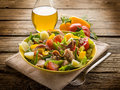 Nicoise salad over wood background Stock Image