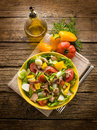 Nicoise salad over wood background Royalty Free Stock Photography