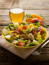 Nicoise salad over wood background Stock Images