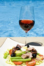 Nicoise Salad  and Pink Wine by the Pool Stock Images