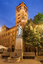 Nicolaus copernicus monument and town hall in torun poland by night erected old city polish ratusz staromiejski Stock Photos