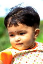 Nieuwsgierige baby-Ii Stock Foto