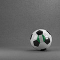 Nigeria soccer ball nigerian in front of plaster wall Stock Photos