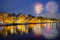 Night Amsterdam city view of Netherlands traditional houses with Royalty Free Stock Photo
