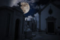 Night cemetery halloween scenery with full moon cloudy sky stars and old european Stock Photography
