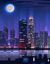Night city megapolis high skyscrapers great big business with a very office buildings reflected in the river in the rays Stock Image