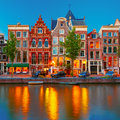 Night city view of Amsterdam canal with dutch Royalty Free Stock Photo