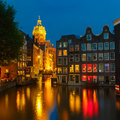 Night city view of Amsterdam canal with dutch hous Royalty Free Stock Photo