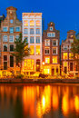 Night city view of Amsterdam canal with dutch houses Royalty Free Stock Photo