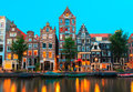 Night city view of Amsterdam canals and typical ho Royalty Free Stock Photo