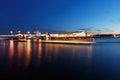 Night cityscape with river and bridge in Saint-Petersburg. Lantern lights on the bridge Royalty Free Stock Photo
