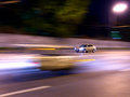 Night driving car abstract urban background with traffic light trails pattern a goes by an urban street with high speed Stock Photos