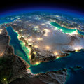 Night earth saudi arabia highly detailed illuminated by moonlight the glow of cities sheds light on the detailed exaggerated Stock Image
