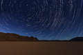 Night exposure star trails of the sky in death valley california vortex Stock Photography