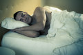 Night an handsome and muscular man sleeping peacefully in a bed Stock Images
