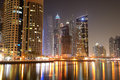 The night illumination at dubai marina and cayan tower uae Royalty Free Stock Images