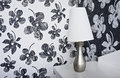 Night lamp is on the background wallpaper with black and white flowers Stock Photo