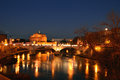 Night landscape with castel sant angelo in rome italy a view of by and the tiber Stock Images