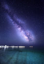 Night landscape with colorful milky way at the sea with stones starry sky space background Stock Image