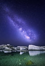 Night landscape with colorful Milky Way at the sea with stones. Starry sky. Space background. Royalty Free Stock Photo