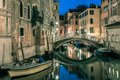 Night lateral canal and bridge in Venice, Italy Royalty Free Stock Photo