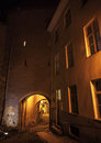 Night in old town of tallinn estonia dark street with illuminated gateway at Stock Photos