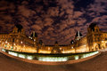 Night panoramic view of the Louvre Museum in Paris, France.