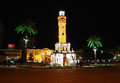 Night place in izmir with clocktower and palms Stock Images