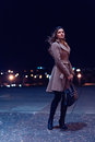 Night portrait young woman walks on a city Royalty Free Stock Photo