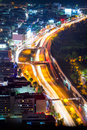 Night road with motion traffic in residential district, city lif