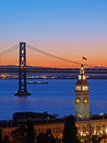 Night Scene of Ferry Building & Bay Bridge Royalty Free Stock Images