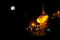Night scene Kyaikhtiyo Pagoda in full Moon night. Royalty Free Stock Photo