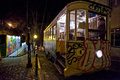 Night scene of a lisbon tram an illuminated innercity yellow with woman standing inside stopped at the side street to allow Stock Images