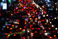 Night scene out of focus lights from cars in grave traffic jam after working hours in central business district. Motion Blur. Royalty Free Stock Photo