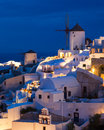 Night shot oia santorini greece dusk overlooking buildings on the caldera at europe Royalty Free Stock Image