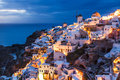 Night shot oia santorini greece dusk overlooking buildings on the caldera at europe Stock Image