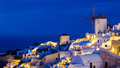 Night shot oia santorini greece dusk overlooking buildings on the caldera at europe Stock Photography