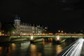 Night shot of the pont au change paris over seine river in france Stock Images