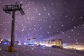 Night on ski resort pas de la casa andorra and snowboard with lift snowfall and illuminated village Stock Photography