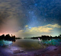 Night sky above lake seliger in russia landscape with bright starts Stock Photo