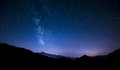 Night sky stars with milky way on mountain background panorama moving and behind Royalty Free Stock Photography