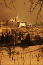 Night snowy prague city with gothic castle czech republic Stock Image