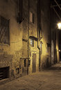 Night streets of pisa italy ancient alleyway in tuscany at Royalty Free Stock Photos