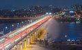 Night traffic blurs past Banpo Bridge Rainbow Fountain in Seoul, Royalty Free Stock Photo