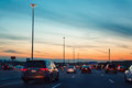 Night traffic, cars on highway road on sunset evening night in busy city Royalty Free Stock Photo
