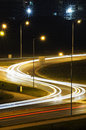 Night traffic s shaped car traces on the road in the city at Stock Photography