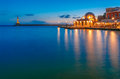 Night venetian quay chania crete picturesque view of of with lighthouse and kucuk hasan pasha mosque during mornng blue hour Royalty Free Stock Photo