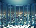 Night view of buildings from high rise window Royalty Free Stock Photo