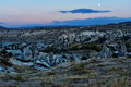 Night view of cave houses and rock formations. Goreme. Cappadocia. Turkey Royalty Free Stock Photo